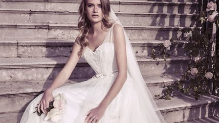 This beautiful A-line dress in soft tulle and lace is by Ellis Bridals, £1,710 from Celebrations of