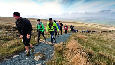 Walkers take on the challenging terrain of the Three Peaks of Whernside, Ingleborough and Penyghent