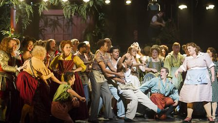Opera Norths production of Cole Porters Kiss Me, Kate featuring Wayne Robinson as Paul (white vest)