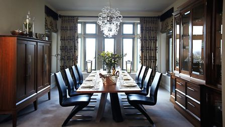 Classic elegance meets modern design in this timeless dining room