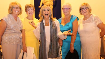 Lesley Garrett with Lost Chord volunteer Sheila Bunting to her right and guests