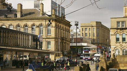 The Plaza Centre, Huddersfield Town Hall and Ramsden Street.