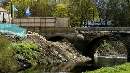 Flood water swept away part of Tadcaster's bridge spliting the town in two