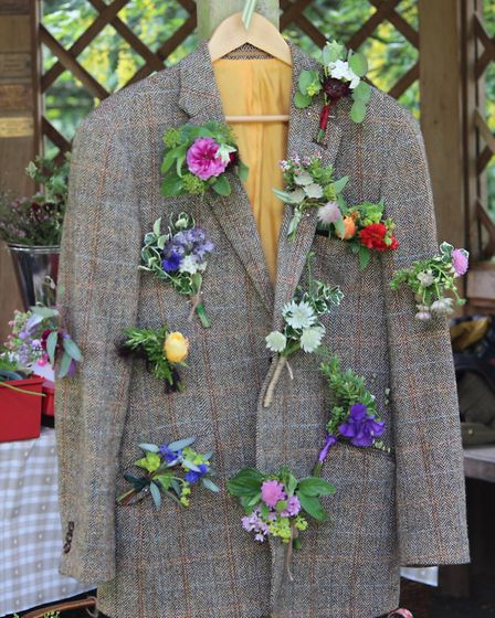 Flower adornments on a tweed jacket