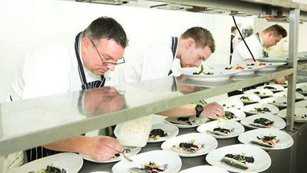 Head chef and his team in the kitchen
