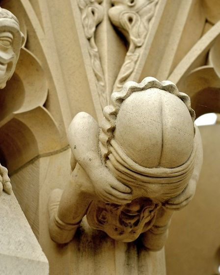 """A series of 'Grotesque"""" carvings with Medeival ailment theme,at the base of the south east pinnacle."""