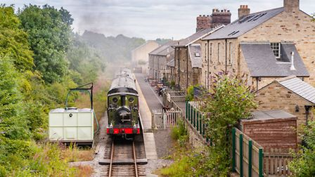 A steam train engine arrives at Leyburn station, part of the Wensleydale Railway Line