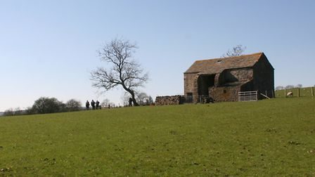 Walkers reach the lonely barn of Farlands Laithe