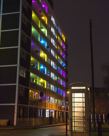 Tinted filters in communal lighting areas and coloured sheets cover window panes across five high-ri