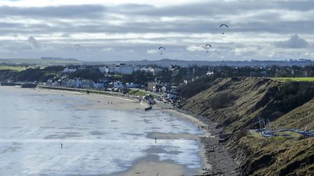 View across the bay and town centre to open countryside beyond from Filey Brigg
