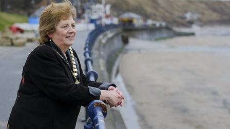 Filey town mayor, Susan Bosomworth with the Brigg and beach in the background