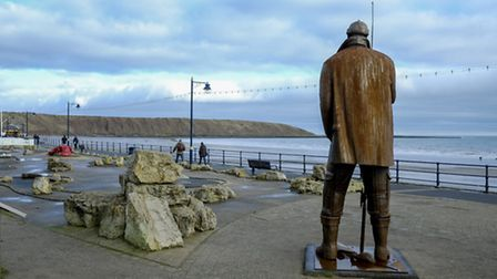 The sculpture High Tide in Short Wellies by Ray Lonsdale looks out across the bay