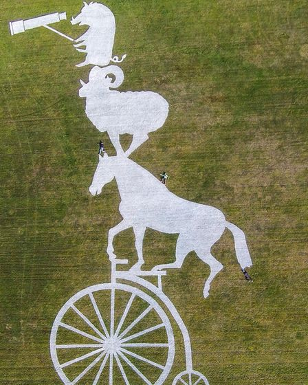A giant piece of art featuring a horse, ram and wild boar riding a penny farthing on Sutton Bank, No