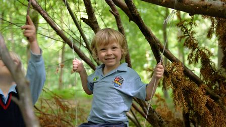 A mini St Martins pupil enjoys a mini outdoor adventure in the innovative Forest School