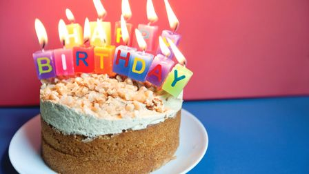 Toms running out of room for candles on his birthday cake, but hes going to remain cheery