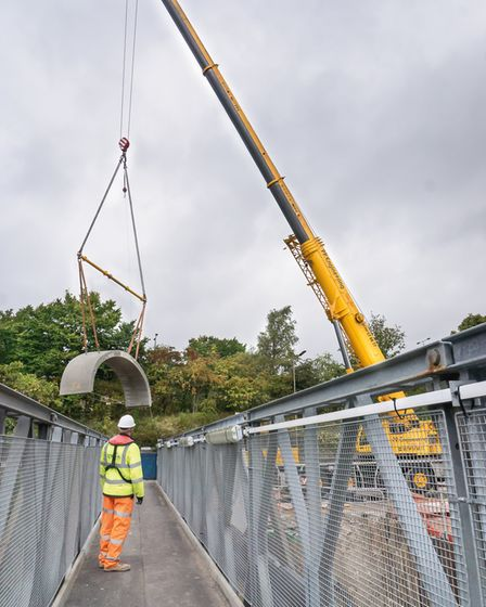 Mike Bentley captures the lifting of one of the arches in the rebuilding of Elland Bridge