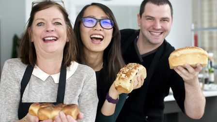 Michelle Sykes,Rane Lin and James Gorton with fruit loaves made in the cookery class.