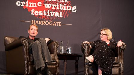 Lee Child being interviewed by Sarah Millican at a previous festival