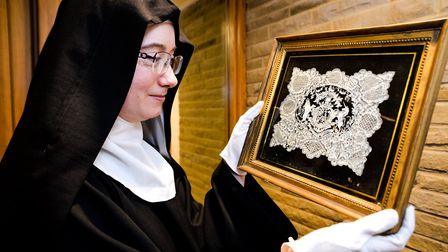 Sister Marian Sweeting-Hempshall with the framed English Coat of Arms