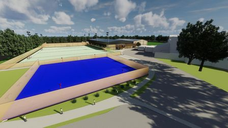 The new netball and tennis courts in blue with the full size artificial hockey pitch behind