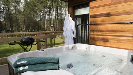 Each lodge has its own hot tub and sauna installed