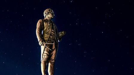 A starry sky behind the Captain Cook monument on the West Cliff at Whitby.Eighteenth century sci