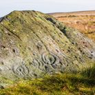 Cup and ring marks on the ancient Badger Stone on Ilkley Moor Photo: Alamy