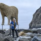 Whitby based sculptor Emma Stothard at work installing her life-size polar bear made from willow on