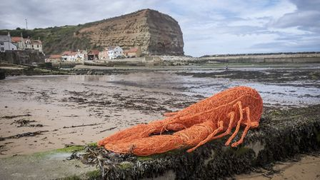Lobster on the sea shore, a work of art from an earlier Staithes Festival of Arts