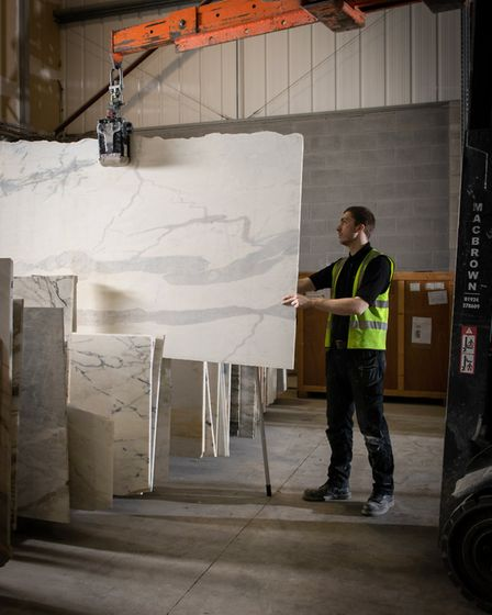 A large selection of marble slabs available to choose from in the warehouse