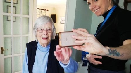 Carers can help customers keep in touch with family and friends by using applications such as Facetime and Zoom. Picture...
