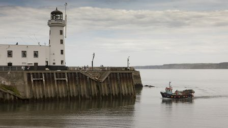 The boat returns on calm water to Scarborough harbour