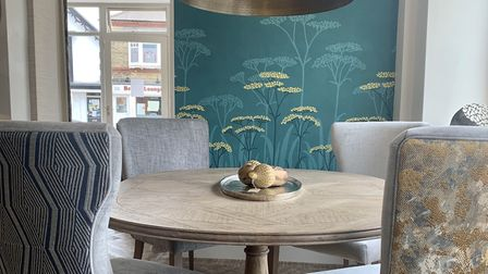 Navy and dark blues and natural green and earthy colours are a current popular interior design trend. Picture: Furnish and...