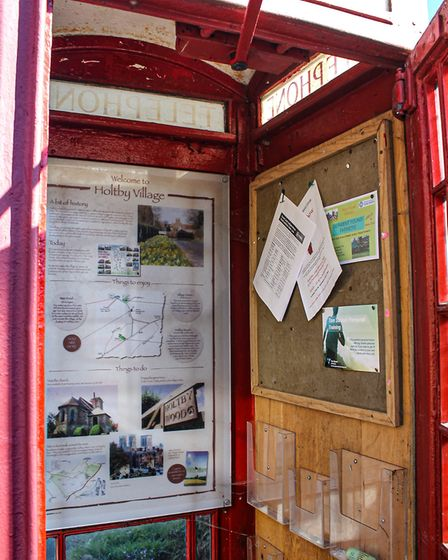 Holtby's phone box tells visitors about the village