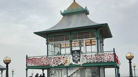 Clevedon Pier was decorated with woollen poppies knitted by volunteers