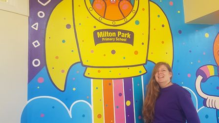 Emily with her mural at Milton Park Primary School.