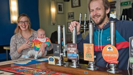 Landlords Kaylie and Tom Conibear with daughter Elsie at the Brit Bar which is featured in the CAMBR