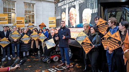 Liberal Democrat Brexit spokesperson Tom Brake (centre) as the party launches four poster vans that