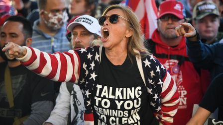 A Donald Trump supporter yells at counter-protesters outside the US Supreme Court during the Million MAGA March in Washington