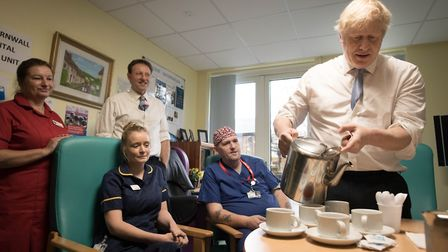 Prime Minister Boris Johnson meets staff at West Cornwall Community Hospital. Photograph: Stefan Rou