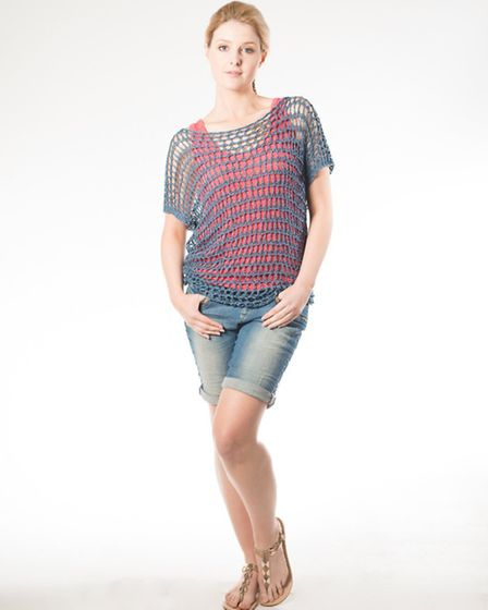 Pako Litto large loop, throw-over knit is a stylish summer accessory. Wear over a bikini or a vest t