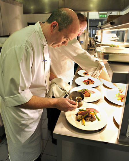 Ian Booth, Head Chef, prepares lunch.