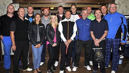 Sporting celebrities line up for event photo