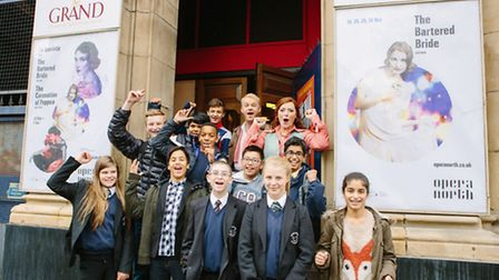 Pupils give a schools performance of The Bartered Bride in 2014 the thumbs up. Next years schools pe