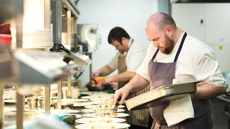 Head chef Nick Evans plates up the starter course