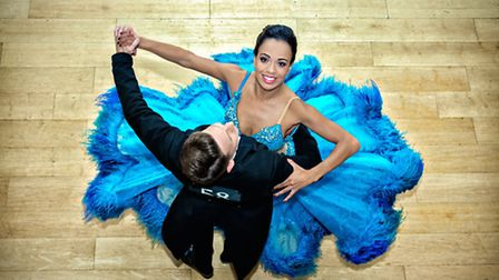 Courtney-Mae Briggs, with James Bennett, wears a show-stopping turquoise gown in Strictly Ballroom