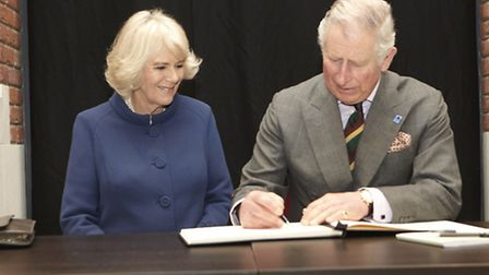 The royal couple sign the visitors' book at Ferens Art Gallery