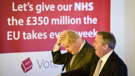 Boris Johnson (left) outlines a vision for Brexit watched by former Defence Secretary Dr Liam Fox. P