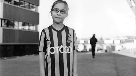 A young fan proud of her team