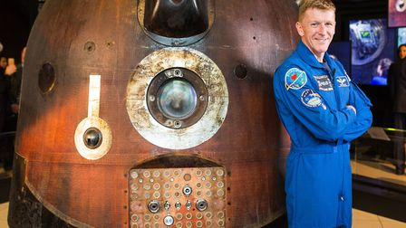 Astronaut Tim Peake with the Soyuz spacecraft now on display at the National Railway Museum, York P